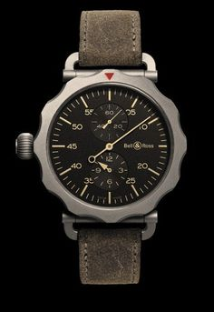 Bell & Ross WWII Bomber Regulator Watch. Love the utility-look of this beautifully designed chronograph.  The scalloped bezel is echoed in the very subtle patterning behind the smaller dials. They don't make 'em like this anymore.