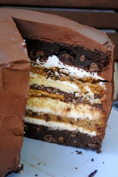 Ultimate S'More Anniversary Cake ~ 7 layers... 2 brownie layers, 2 cheesecake layers, 2 chocolate chip cookie layers, 5 graham crackers, marshmallow frosting and chocolate Frosting