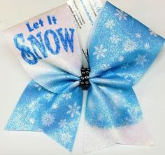 Bows by April - Let it Snow Christmas Winter Cheer Bow, $15.00 (http://www.bowsbyapril.com/let-it-snow-christmas-winter-cheer-bow/)
