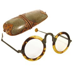 This is a pair of 125+ year old and delicate ox horn eyeglasses in the original shagreen and decorative copper case. C0-0L
