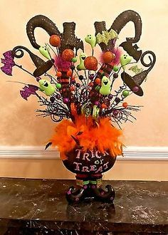 Listed is a Halloween arrangement made with only the finest high end designer materials. Arrangement measures x L:x txzj Diy Halloween Decorations, Halloween Centerpieces, Halloween Wreaths, Scary Halloween, Halloween Ideas, Halloween Stuff, Fall Boards, Prop House, Witch Legs