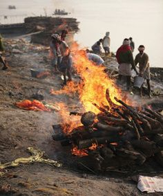 Funeral Pyre at Benares, India on Ganges River. Google Image Result for http://www.artofphotographyshow.com/2008/Masahito-Otake_Cremation-Bu.jpg