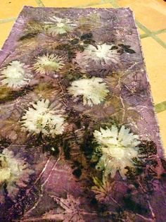 Ecoprint, naturaldyes, daisies and logwood on cotton https://www.facebook.com/witcheskitchen007