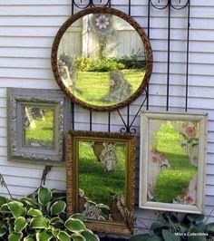 le vieil miroir accroché au mur de jardin