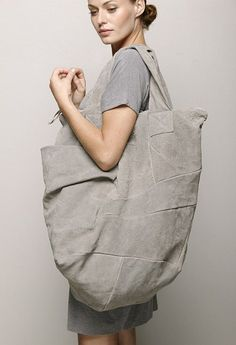 Pleated and Patch worked Bag on a grand scale just about fit everything in.