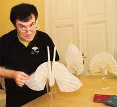 Extravagant swan napkin folds.