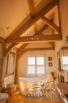 Case Study: Oak extension combines clean, architectural lines with natural warmth - Oakmasters Budget Bathroom Remodel, Small Bathroom Storage, Oak Framed Extensions, Small Bathroom, Modern Log Cabins, Small Bathroom Renovations, Bathroom Design, Shower Tile Designs, Beautiful Bathrooms