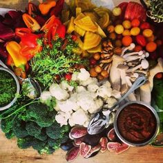 Caveman Cafeteria served up this gorgeous seasonal vegetable crudité platter at a Colorado wedding.