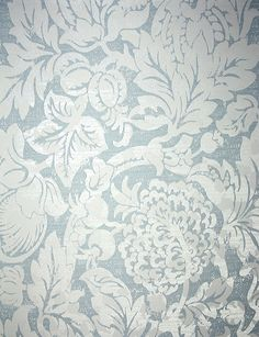 Beauchamp Wallpaper An elegant damask wallpaper incorporating metallic and iridescent inks and layered textures in a scrolling leaf motif. Printed in pale blue.