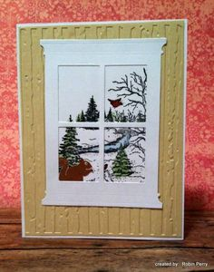 by Robin Perry.... snow scene with a squirrel on the outside window sill