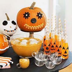 Clever candy-decorated pumpkins transform a buffet-table soda station into a fun-filled focal point. Simply hot-glue various black, orange, and white candies onto pumpkins instead of carving.