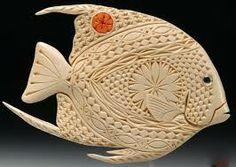 Resultado de imágenes de Google para http://www.cmstatic1.com/113264/c/french-angelfish-carving--UDU2Ny0xMTMyNjQuMzg4MjQy.jpg
