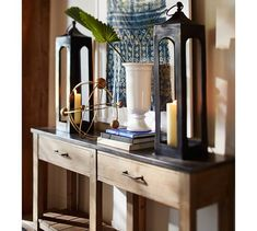 Decorate a console table with a pair of lanterns - beautiful! Metal Lanterns, Lanterns Decor, Outdoor Candles, Foyer Decorating, Decorating Ideas, Entry Foyer, White Vases, Pottery Barn, Home Accessories