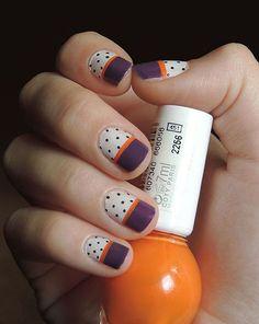 Urban jungle as base with black stripe and polka dots nail art.