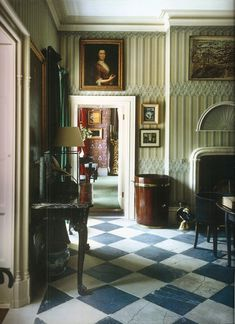 The owner of Luggala in County Wicklow, Ireland wanted it to be as it had always been. I love the hand blocked grisaille Gothic wallpaper in the hall/dining room.