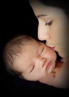 Newborn, a mother's kiss