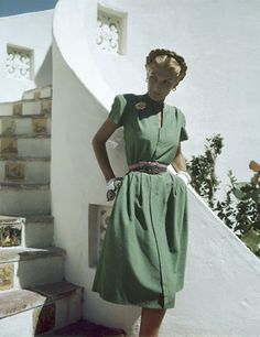 1945    Model is wearing a grass-green shantung dress, Hollywood pattern No. 1610.