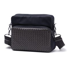 This highly organized, sporty messenger bag is crafted in hi-tech canvas and elevated by silky hand-woven matte calf leather detailing. Ideal for everyday use thanks to the two roomy cotton-lined compartments, divided by a flat partition, and generous zipped pockets on the front and back. The adjustable nylon strap makes it easy to carry over the shoulder or cross-body.