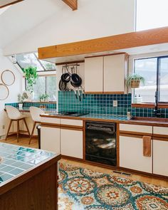 This Home's Emerald Backsplash and Kitchen Rug Combo Will Make You Green with Envy All White Kitchen, New Kitchen, Danish Kitchen, Kitchen Layout, Kitchen Design, Kitchen Backsplash, Kitchen Cabinets, Countertop, Old Kitchen Tables