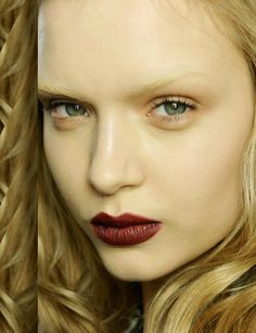 "Gucci model make up in a ""Romantic Goth""theme for the autumn/winter 2012 make-up trend.  Dark, red lipstick."