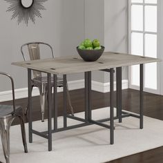 This convertible dining table with its clean lines and fresh look is an updated version of the old gate-leg tables. Its beautiful grey top folds up to go from a dining table to a sofa table in an instant.