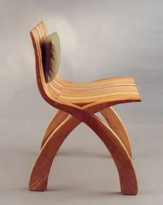 Laminated chair in ash with leather cushion. Lee Sinclair. Simple idea executable in ply or solid wood. Extend the front. Could happily be made to measure.