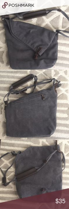NWOT Canvas Bag Stylish and functional cross-body bag with three inside zip pockets. Gray canvas with brown leather trim. Fold over and button closure and an outside zipper for that phone! Another great travel bag! Never used. NWOT COOFIT Bags Crossbody Bags