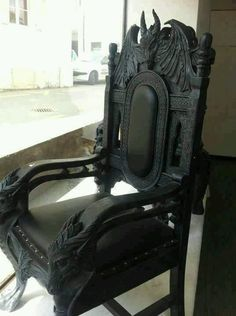 This chair fits into the Gothic era because of the dark colours, and gargoyles in the design.