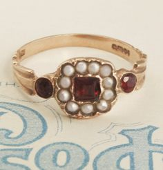 Pretty #garnet and pearl ring. I would wear this with my favorite vintage pieces!