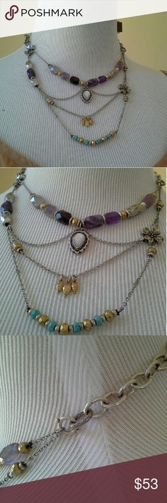"LUCKY BRAND Necklace >>> ONLY 1 LEFT! <<< Lucky lucky lucky! The goes-with-everything necklace. Asymmetrical chain pattern. Silver, gold, with dark and light faceted purple amethyst stones, and small faceted turquoise colored stones. APPROX MEAS: 16.5"" chain. Bottom chain hangs approx 4.5"" below the center. The dogwood flower beads are 9/16"" square for reference. Only 2 available. Lucky Brand Jewelry Necklaces"
