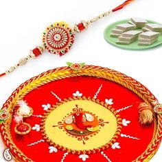 Picture of Hand Crafted Ganapati Shagun Thali with Rakhi and Sweets