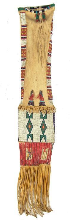 "Sioux Beaded Pipebag ~ Fantastic sinew sewn and lazy stitch beaded buckskin bag with two-sided design, quilled slats (made from painted parfleche), and whiteheart seed beads in the beading.  27"" x 6-1/2"" plus 12"" fringe Circa: Late 1800s"