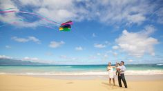 The beach is the erfect place to fly a colorful kite with your little one! Anna Kim Photography