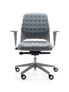 Akaba chair upholstered with Atlantic Bubbles