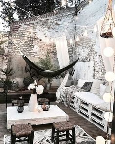 Perfect patio terrace porch for parties or lounging. Tall whitewashed brick wall for privacy and ambiance. Hammock and palette furniture to lounge in on the wooden wood deck. Home design decor inspiration ideas. Home Design Decor, Patio Design, Design Ideas, Balcony Design, Garden Design, House Design, Interior Design, Landscape Design, Pergola Patio