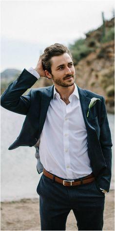 Chic groom attire, navy blue suit, white calla lily bout, no tie // Rachel Ackerman