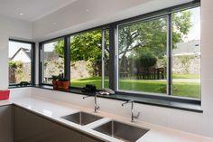 Kitchen sliding corner window