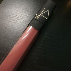 Nars Dulce Vida liquid lipstick gloss Super cute color in my opinion, I just have wayyy too many lipsticks that I dont even use. This has a super rich formula and is not sheer. Never used only swatched. NARS Other