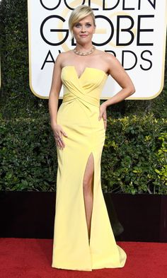 REESE WITHERSPOON wears a custom Atelier Versace  lemon-meringue sweetheart-neckline dress with a high slit and Tiffany & Co. jewelery.