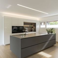 Detached house # Feldkirch # modern wood construction # modern architecture # flat roof # rich … - Home Page House Design, Interior Design Kitchen, Home Decor Kitchen, Kitchen Room Design, Kitchen, Modern Kitchen Design, Flat Roof, Contemporary Kitchen, Kitchen Island Lighting