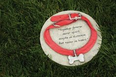 """15"""" Pet Memorial """"Together Forever Never Apart"""" Dog Collar Garden Stone by Evergreen. $29.99. Dog Collar Garden StoneItem #84262Honor the memory of your loyal pet with this memorial garden stone. It notes, """"Together forever never apart, maybe in distance but never in heart""""Dimensions: 12""""L x 12""""W x 1.25""""DMaterial(s): resin. Save 25% Off!"""