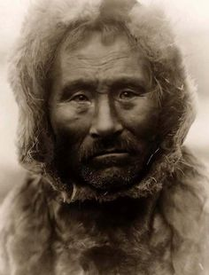 You are looking at an educational picture of a Noatak Eskimo Man. It was taken in 1929 by Edward S. Curtis.    The picture presents a Head-and-shoulders portrait of the Noatak man.    We have created this collection of pictures primarily to serve as an easy to access educational tool. Contact curator@old-picture.com.