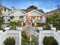 Weatherboard californian bungalow house exterior with porch & landscaped garden - House Facade photo 523009