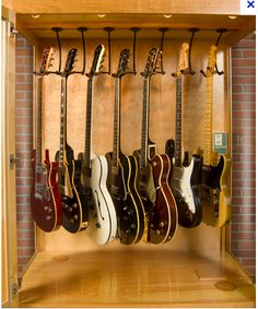 A display case presents the inner-self of the creator. With a look at the display case, you can know the person inside. There are DIY display case ideas. Guitar Hanger, Guitar Wall, Guitar Room, Guitar Display Case, Guitar Storage, Home Music Rooms, Music Studio Room, Sound Studio, Wooden Display Cases