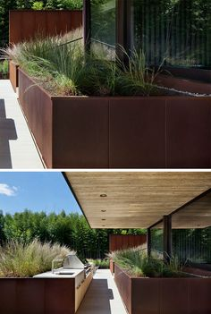 9 Ideas For Including Weathering Steel Planters In Your Garden // Huge planters fill the backyard patio of this family home and make dinner parties feel like they're taking place in the well-groomed great outdoors.