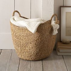 "West Elm Curved Basket, Small, Natural- 12"" square for holding rolls of toilet tissue in lieu of tissue holder on wall."