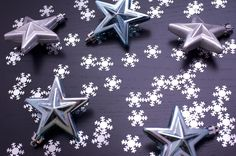 Free Stock Photo: Christmas background pattern of randomly scattered snowflakes and stars on a dark background - By freeimageslive contributor: christmashat