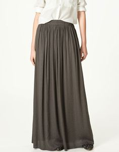 Weat a white button top with the sleeves rolled and down to the floor Zara maxi skirt.