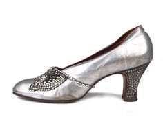 Shoe-Icons / Shoes / Silver kid leather pumps with rhinestones embellished heels.