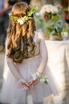 Flower Girl with Curly Hairstyle & Green Crown | Photo: Karlisch Photography.